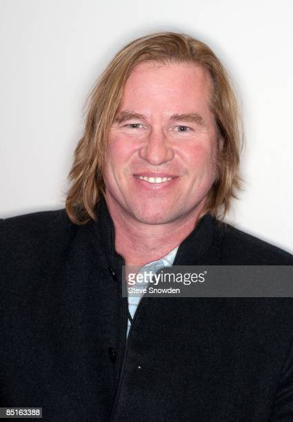 Actor Val Kilmer poses backstage at Route 66 Casino's Legends Theater on February 28 2009 in Albuquerque New Mexico following a performance by...