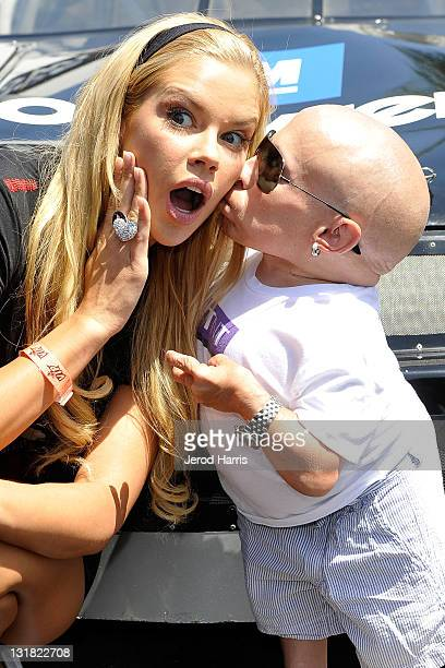 Actor Verne Troyer kisses Playmate Jessa Hinton at the Celebrity GoKart Tournament benefiting the American Diabetes Association at K1 Speed Indoor...