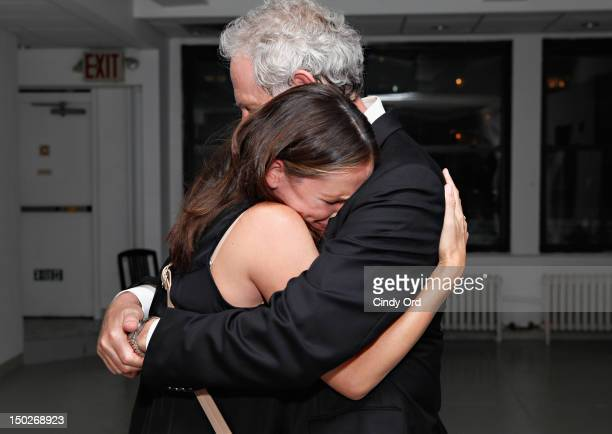 Actor Victor Garber embraces actress Jennifer Garner backstage following his performance at 54 Below on August 13 2012 in New York City