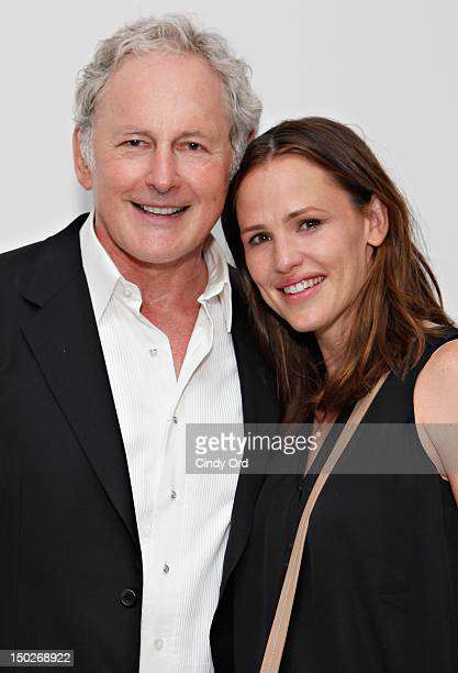 Actor Victor Garber poses with actress Jennifer Garner backstage following his performance at 54 Below on August 13 2012 in New York City