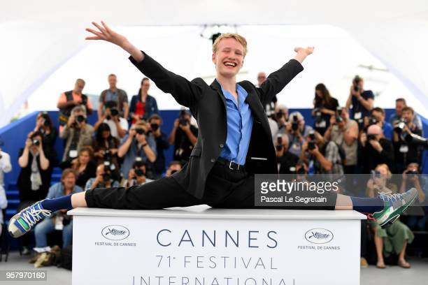 Actor Victor Polster does the splits on the podium as he attends the photocall for 'Girl' during the 71st annual Cannes Film Festival at Palais des...