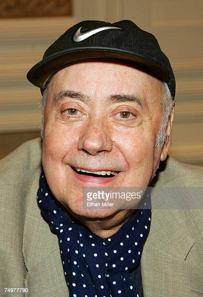 Actor Victor Spinetti poses during an autograph signing session at the Fest for Beatles Fans 2007 at The Mirage Hotel Casino July 1 2007 in Las Vegas...