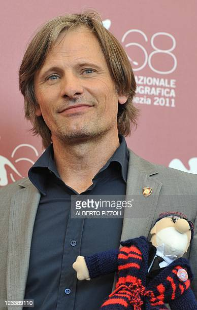 """Actor Viggo Mortensen holds a puppet during the photocall of """"A dangerous method"""" at the 68th Venice Film Festival on September 2, 2011 at Venice..."""
