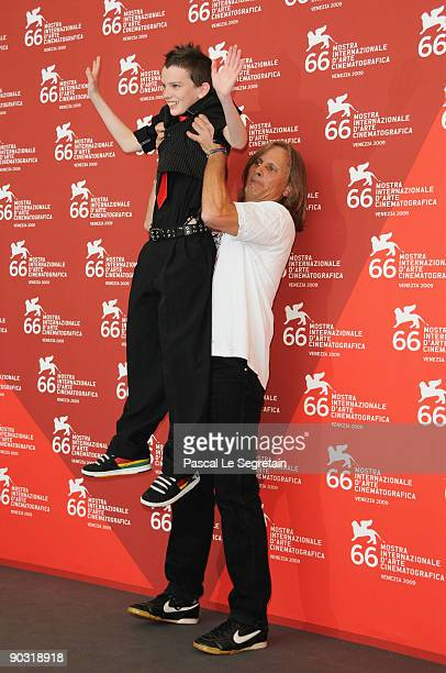 """Actor Viggo Mortensen lifts actor Kodi Smit-McPhee while attending """"The Road"""" photocall at the Palazzo del Casino during the 66th Venice Film..."""