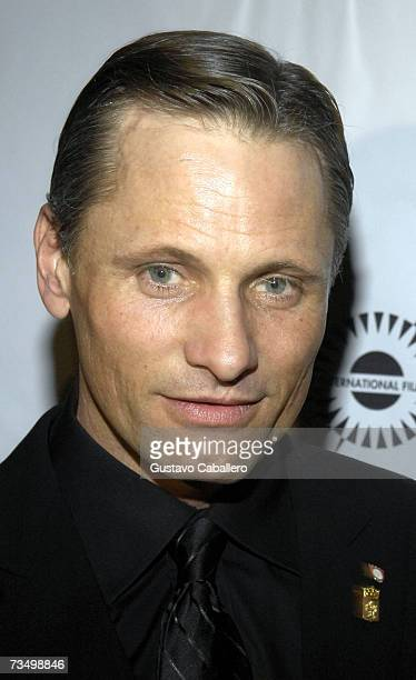Actor Viggo Mortensen poses on the red carpet before the screening of Alatriste at the Gusman Theater during the Miami International Film Festival...