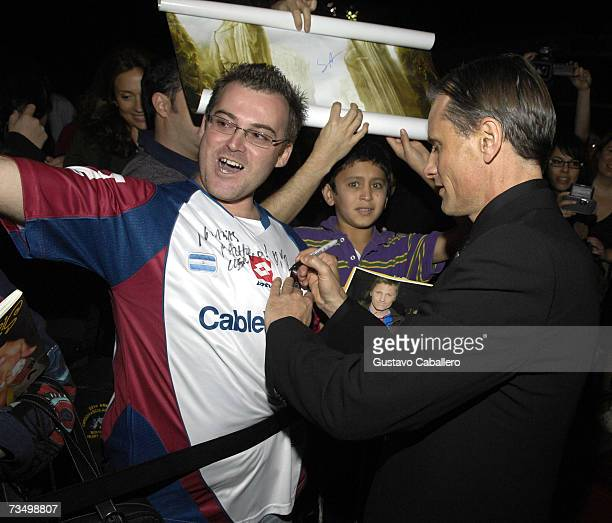 Actor Viggo Mortensen signs autographs before the screening of Alatriste at the Gusman Theater during the Miami International Film Festival March 5...
