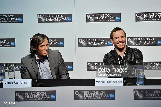 Actor Viggo Mortenson and actor Michael Fassbender attend the press conference for A Dangerous Method at the 55th BFI London Film Festival at Vue...