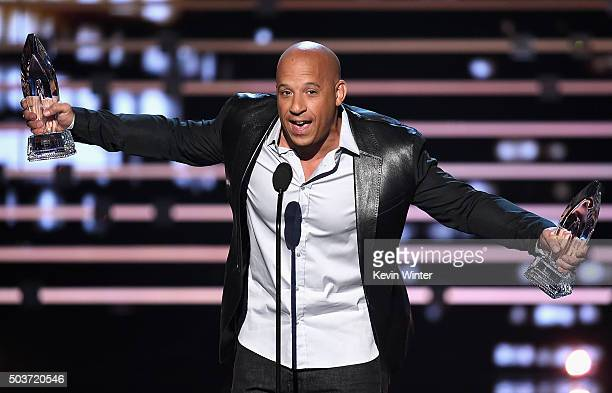 Actor Vin Diesel accepts the Favorite Movie and Favorite Action Movie awards for 'Furious 7' onstage during the People's Choice Awards 2016 at...