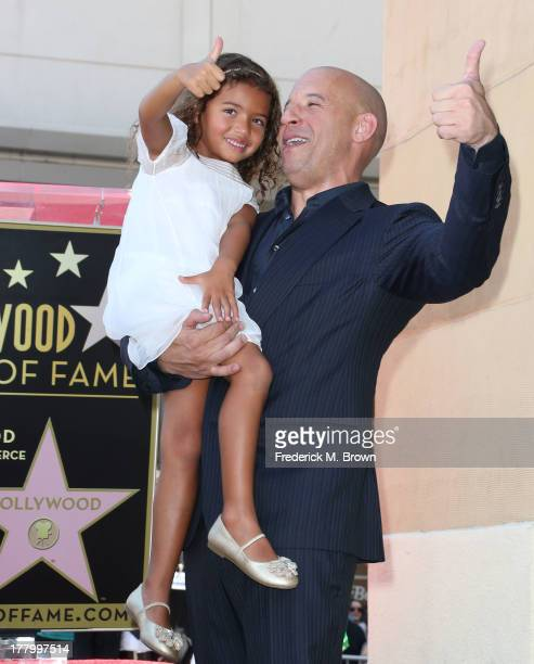 Actor Vin Diesel and his daughter react during ceremony honoring him on The Hollywood Walk of Fame on August 26 2013 in Hollywood California