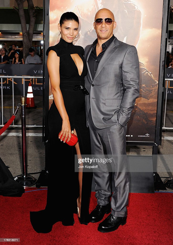 Actor Vin Diesel (R) and model Paloma Jimenez arrive at the Los Angeles Premiere 'Riddick' at the Mann Village Theater on August 28, 2013 in Westwood, California.