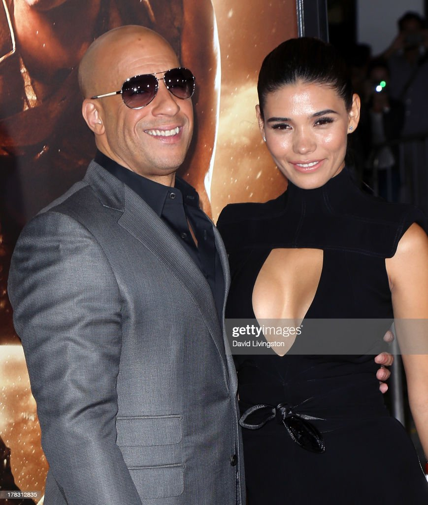 Actor Vin Diesel (L) and Paloma Jimenez attend the premiere of Universal Pictures' 'Riddick' at the Mann Village Theatre on August 28, 2013 in Westwood, California.