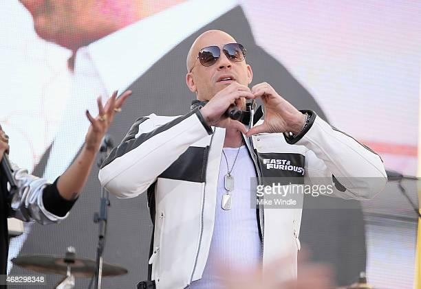 Actor Vin Diesel forms a heart with his hands onstage during an exclusive 'Furious 7' concert hosted by REVOLT Live at Hollywood Studio at Hollywood...