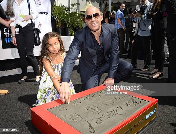 Actor Vin Diesel helps his daughter Hania Riley leave a thumbprint during Diesel's hand and footprint ceremony in Hollywood California April 1 2015...