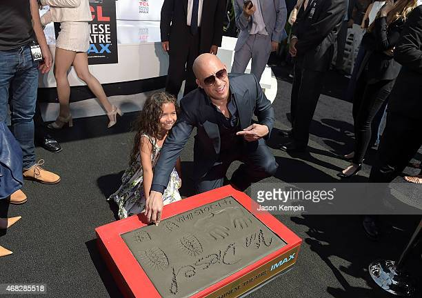 Actor Vin Diesel helps his daughter Hania Riley leave a thumbprint during Diesel's hand and footprint ceremony at TCL Chinese Theatre IMAX on April 1...