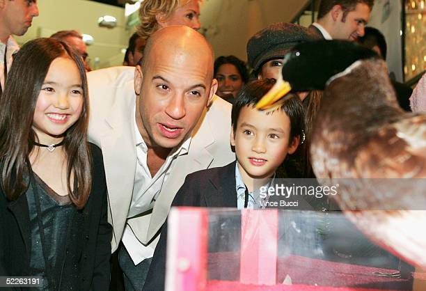 Actor Vin Diesel pose with his niece and nephew with Gary the Duck at the afterparty for the premiere of the Disney film 'The Pacifier' on March 1...