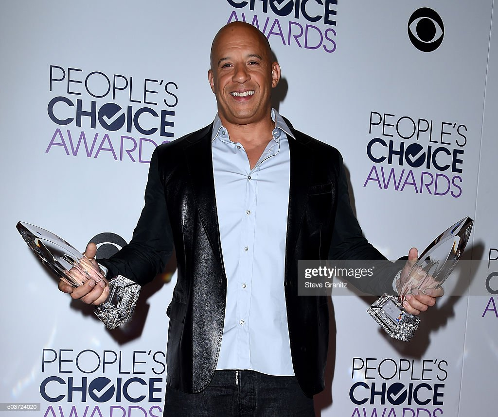 Actor Vin Diesel poses with awards in the press room during the People's Choice Awards 2016 at Microsoft Theater on January 6, 2016 in Los Angeles, California.