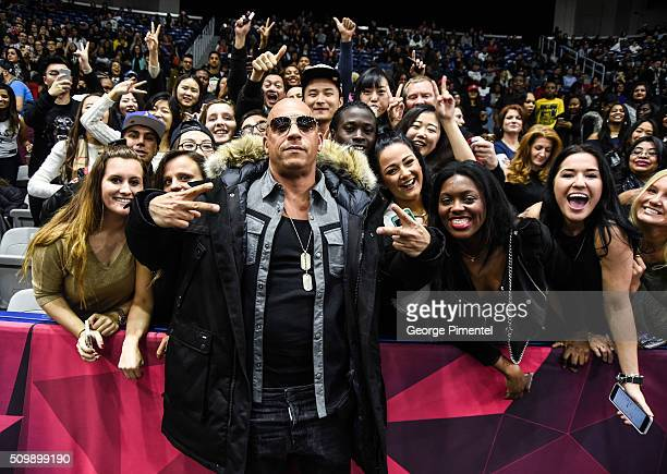 Actor Vin Diesel poses with fans at the 2016 NBA AllStar Celebrity Game at Ricoh Coliseum on February 12 2016 in Toronto Canada