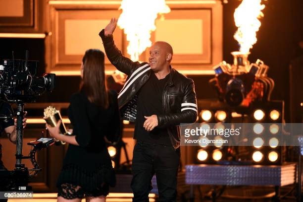 Actor Vin Diesel R accepts the MTV Generation Award for 'The Fast and the Furious' franchise onstage from actor Gal Gadot onstage during the 2017 MTV...