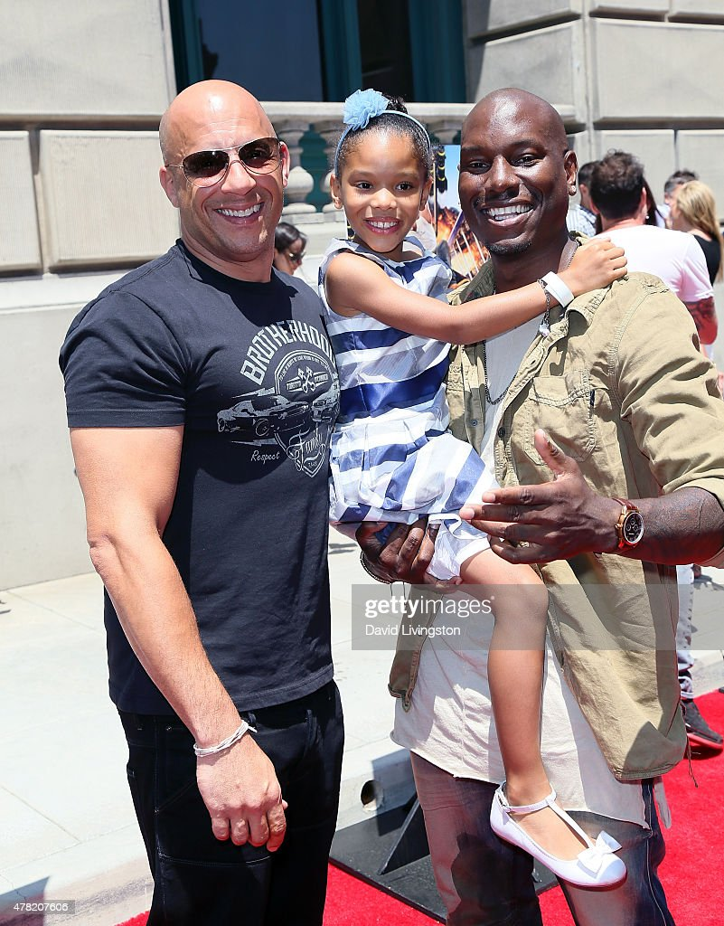 Actor Vin Diesel, Shayla Somer Gibson and father actor Tyrese Gibson attend the 'Fast & Furious - Supercharged' ride premiere at Universal Studios Hollywood on June 23, 2015 in Universal City, California.
