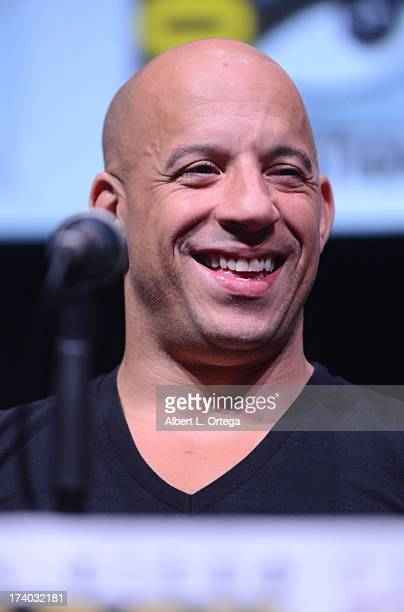 Actor Vin Diesel speaks onstage at the 'KickAss 2' and 'Riddick' Panels during ComicCon International 2013 at San Diego Convention Center on July 19...
