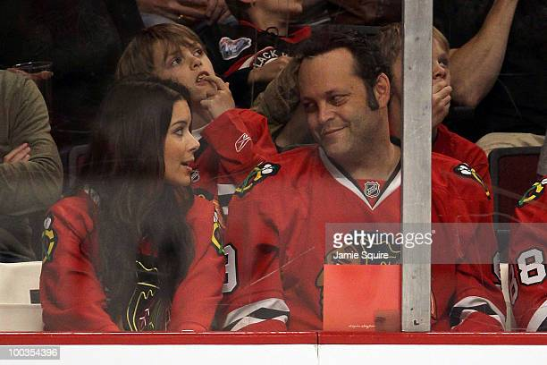 Actor Vince Vaughn and wife Kayla Weber sit glance at each other during the second period of Game Four of the Western Conference Finals during the...
