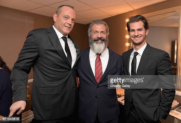 Actor Vince Vaughn director Mel Gibson and actor Andrew Garfield pose in the green room during the Hollywood Film Awards on November 6 2016 in West...