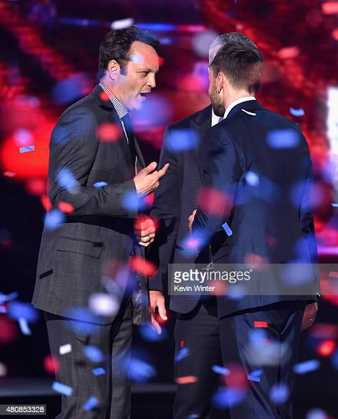 Actor Vince Vaughn former NFL player Brett Favre and host Joel McHale speak onstage during The 2015 ESPYS at Microsoft Theater on July 15 2015 in Los...