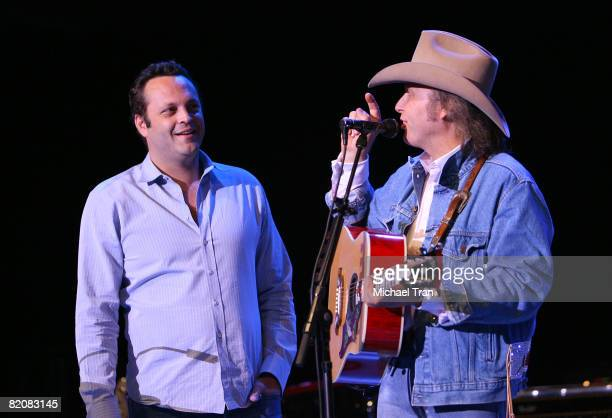 Actor Vince Vaughn presents Musician Dwight Yoakam with gold record on behalf of Warner Music on stage at Go Country 105's Summer Under The Stars...