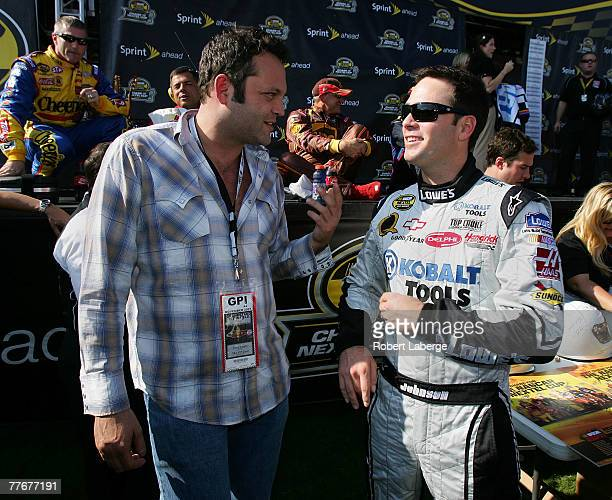 Actor Vince Vaughn talks with Jimmie Johnson driver of the Lowe's/Kobalt Chevrolet prior to the NASCAR Nextel Cup Series Dickies 500 at Texas Motor...