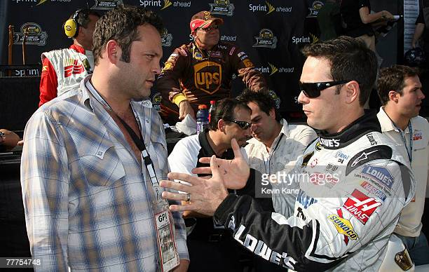 Actor Vince Vaughn the honorary pace truck driver talks to driver Jimmie Johnson prior to the 2007 Dickies 500 NASCAR Nextel Cup Series race November...