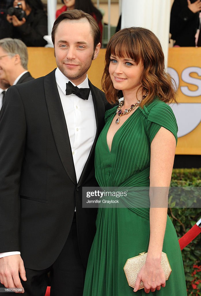 Actor Vincent Kartheiser and actress Alexis Bedel arrive at the 19th Annual Screen Actors Guild Awards held at The Shrine Auditorium on January 27, 2013 in Los Angeles, California.