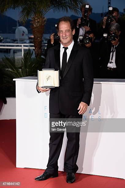 Actor Vincent Lindon winner of the Best Actor Prize for his role in the film ' La Loi du Marche' poses at the photocall for the winners of the Palm...
