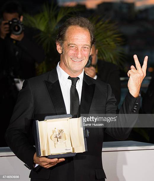Actor Vincent Lindon winner of the Best Actor Prize for his role in the film ' La Loi du Marche' poses attends a photocall for the winners of the...