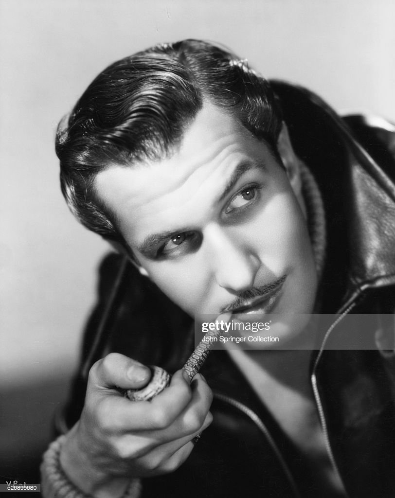 Actor Vincent Price Holding Pipe : News Photo