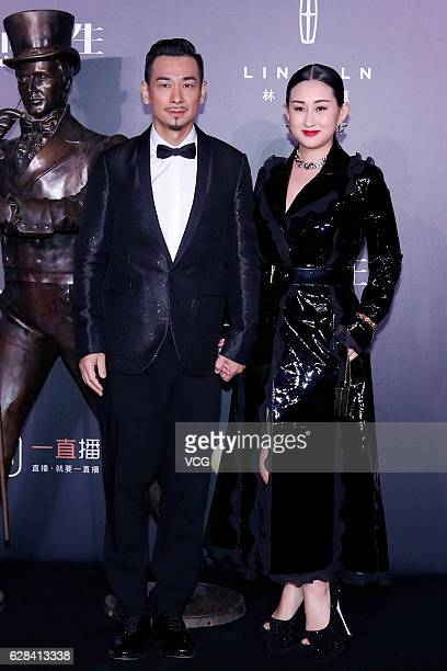 Actor Vincent Zhao Wenzhuo and wife Zhang Danlu pose on the red carpet of the 13th Man At His Best Award at the Worker's Stadium on December 7 2016...