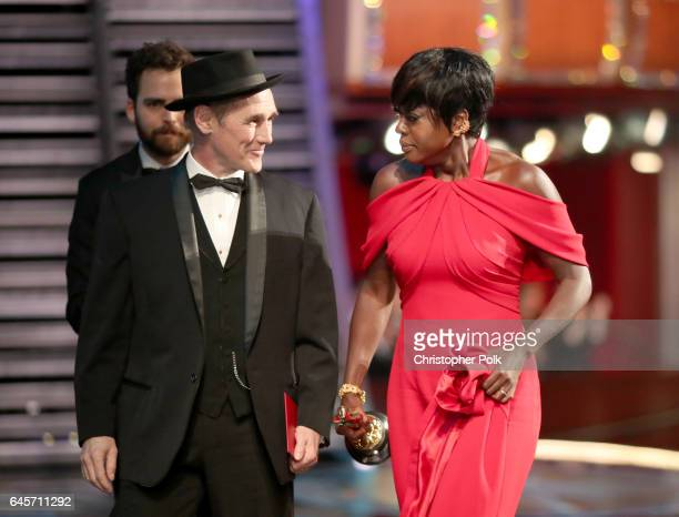 Actor Viola Davis accepts the Best Supporting Actress award for 'Fences' from actor Mark Rylance onstage during the 89th Annual Academy Awards at...