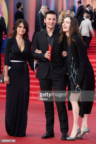 Actor Vyacheslav Manucharov with companions attend opening of the 39th Moscow International Film Festival outside the Karo 11 Oktyabr Cinema on June...