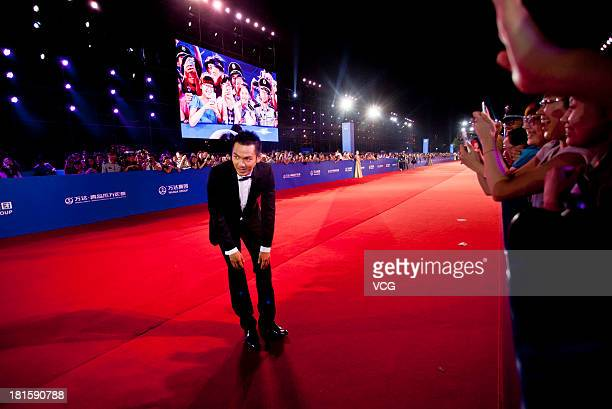 Actor Wallace Chung arrives on the red carpet during the opening night of the Qingdao Oriental Movie Metropolis at Qingdao Beer City on September 22...