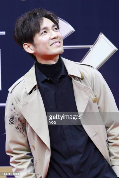 Actor Wallace Chung poses on the red carpet of 2017 Weibo Awards Ceremony at National Aquatics Center on January 18 2018 in Beijing China