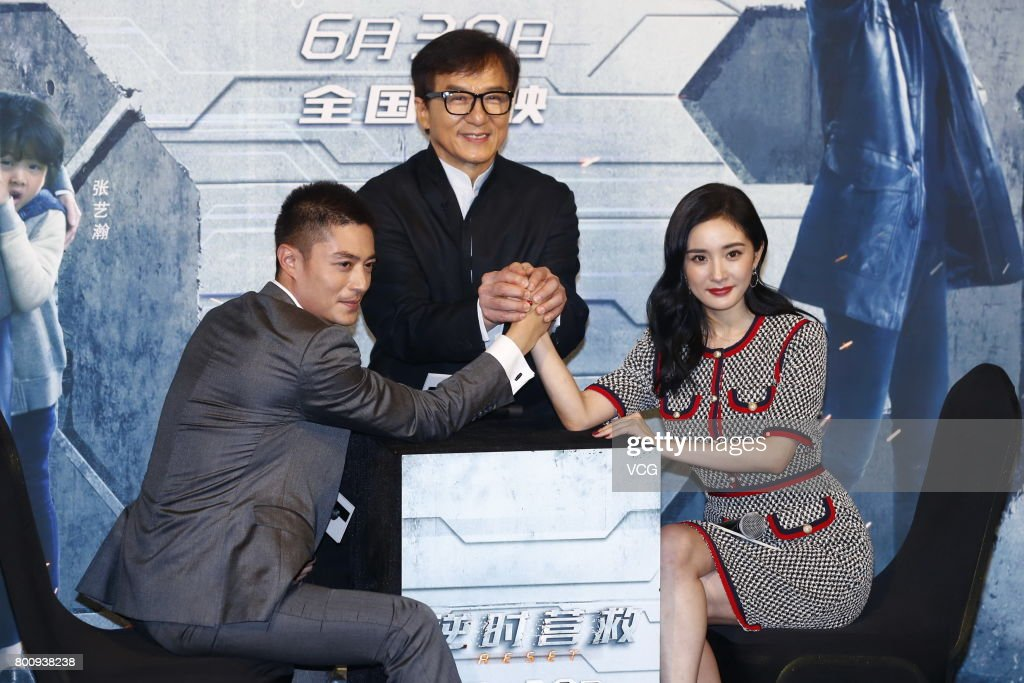 Actor Wallace Huo Chien-hwa, actor Jackie Chan and actress Yang Mi attend the premiere of South Korean director Chang Yoon Hong-seung's film 'Reset' on June 25, 2017 in Beijing, China.