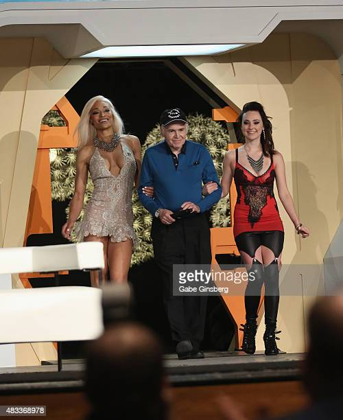 Actor Walter Koenig is escorted on stage by two cosplay models during the 14th annual official Star Trek convention at the Rio Hotel Casino on August...