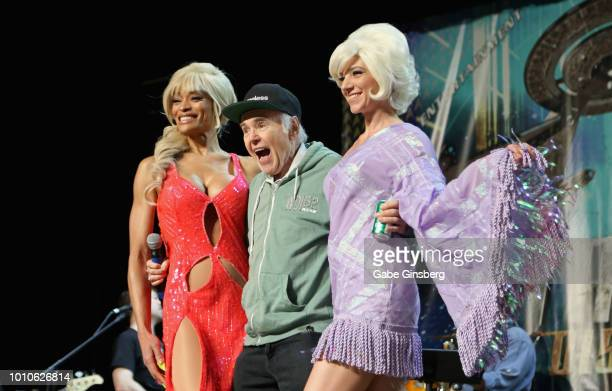 Actor Walter Koenig is escorted onstage by models Alicia Marie of California and Stefany Torres of Texas at the Walter Koenig panel during the 17th...