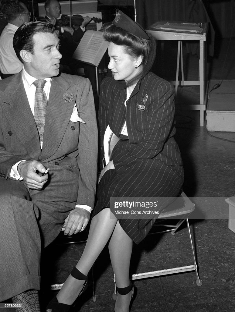 Actor Walter Pidgeon and actress Olivia de Havilland attend an event in Los Angeles, California.