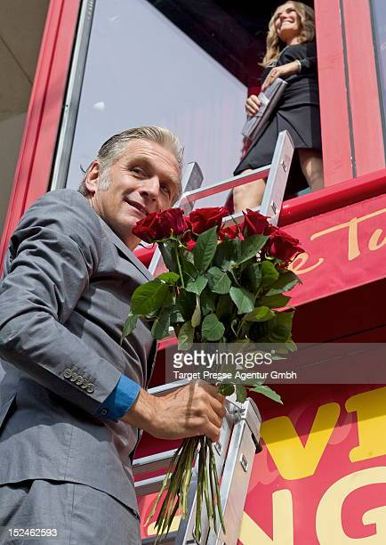 Actor Walter Sittler climbs up a ladder to the first floor of 'Madame Tussauds' to welcome the new wax figure of actress Julia Roberts at Madame...