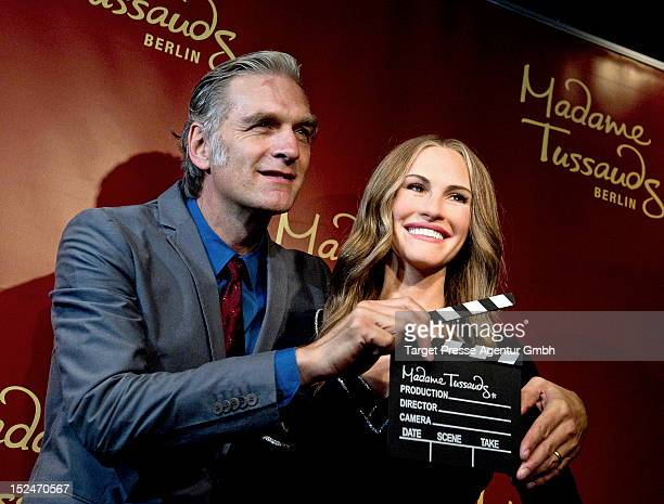Actor Walter Sittler poses with the new wax figure of Actress Julia Roberts at Madame Tussauds on September 21 2012 in Berlin Germany