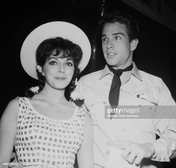 Actor Warren Beatty and actress Joan Collins attend a party in Los Angeles California
