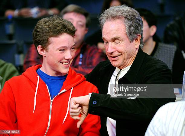 Actor Warren Beatty and his son Benjamin talk during the 2011 NBA AllStar game at Staples Center on February 20 2011 in Los Angeles California