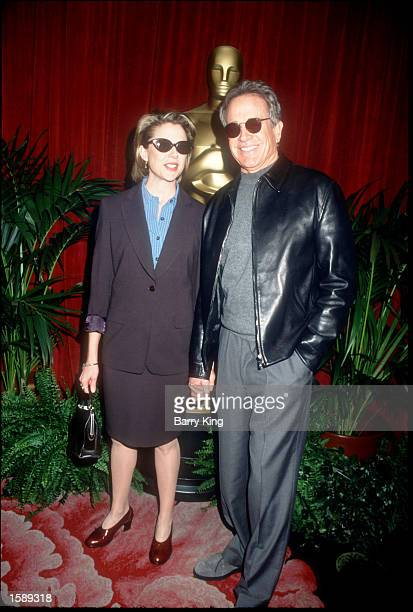 Actor Warren Beatty and his wife Annette Bening attend the Academy Award Nominee Lunch March 8 1999 in Los Angeles CA Bening was nominated for the...