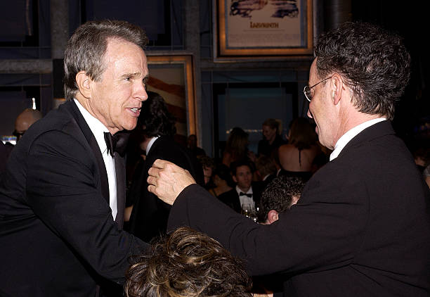 The 33rd afi life achievement award dinnerroaming photos and images actor warren beatty and producer mark canton greet each other during the 33rd afi life achievement m4hsunfo