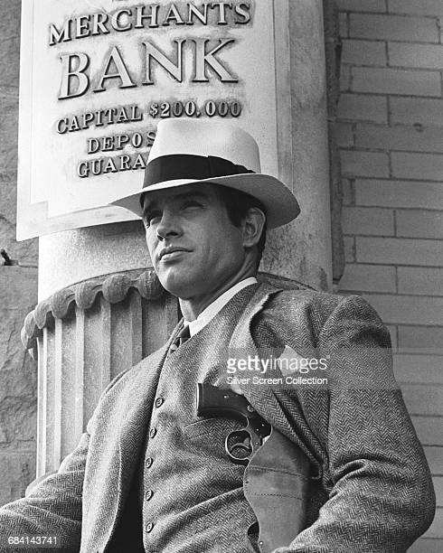 Actor Warren Beatty as bank robber Clyde Barrow standing outside the Merchants Bank in the film 'Bonnie and Clyde' 1967